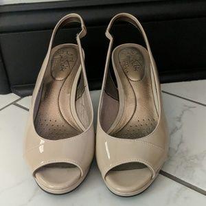 Comfy nude peep toe heels